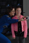 Astronaut Nicole Stott with girl taking selfie
